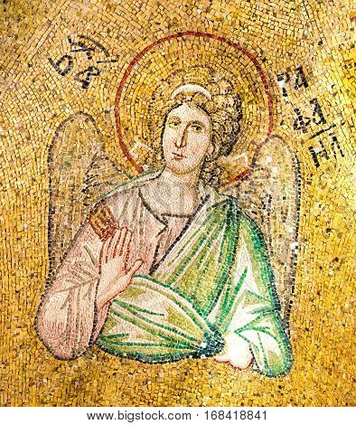 Byzantine mosaic of the archangel Raphael blessing with his right hand. Pammakaristos church Istanbul - October 11,  2013