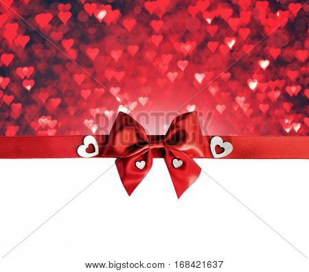 Red gift bow and hearts isolated on white background