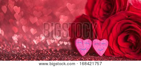 Roses and hearts on red glowing bokeh hearts background for Valentines day