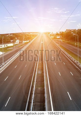 The empty multi lane highway at sunset