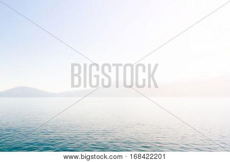Land in sight throw the fog near the Peloponnese Greece