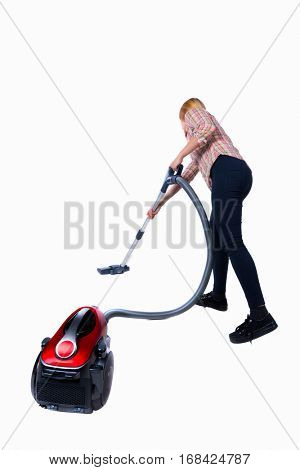 Rear view of a woman with a vacuum cleaner. She is busy cleaning. Rear view people collection. backside view of person. Isolated over white background. cleaner cleans the floor with a vacuum cleaner.