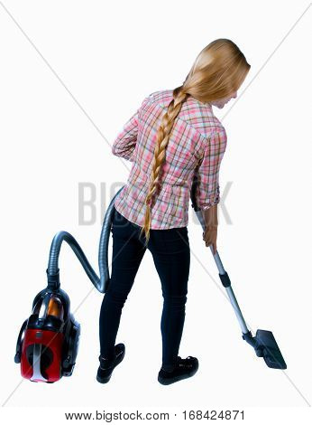 Rear view of a woman with a vacuum cleaner. She is busy cleaning. Rear view people collection.  backside view of person.  Isolated over white background. Girl in plaid shirt vacuuming underfoot.