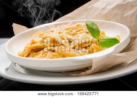 Creamy roasted butternut pumpkin penne pasta with parmesan cheese.