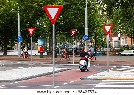 Many road signs on a street in Amsterdam. Caring for the road traffic. Netherlands, Amsnerdam, 29 July, 2013.