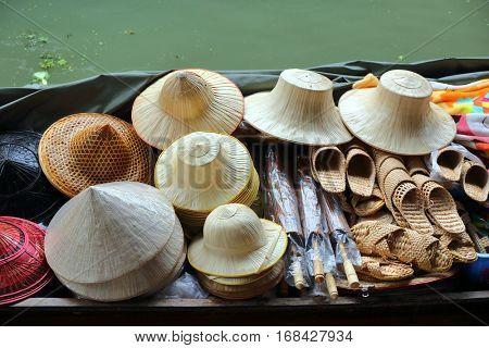 Boat with hats on floating market Damnoen Saduak in Bangkok, Thailand