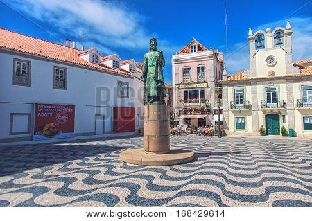 CASCAIS PORTUGAL - SEPTEMBER 28 2013: view of the historical city center with Edificio do Relogio and monument of the King Pedro I in Cascais Portugal