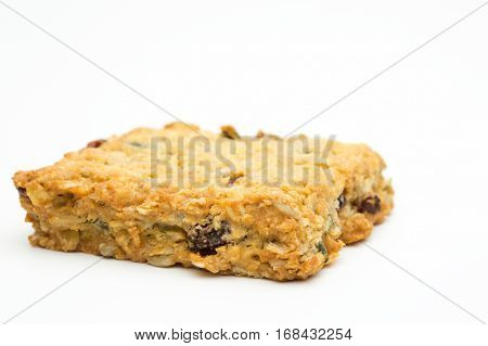 Granola cereal bar on a white background