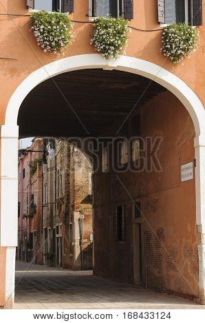 Narrow cobblestone alley in the historical centre of Venice Veneto Italy Europe