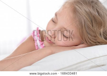 cute little girl sleeping at her bad