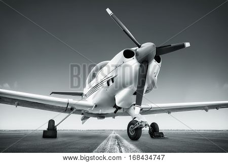 sports plane on a runway ready for take off