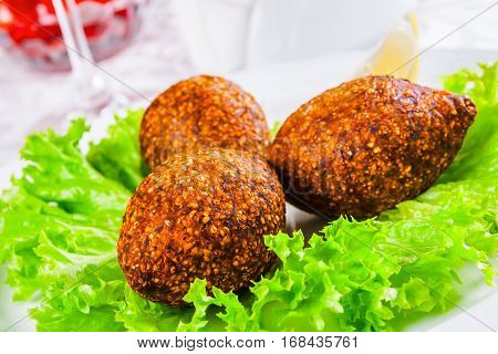 Icli kofta. Turkish dish. Meatballs with bulgur