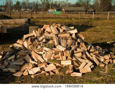 Pile of firewood. Background of dry chopped firewood logs in a pile