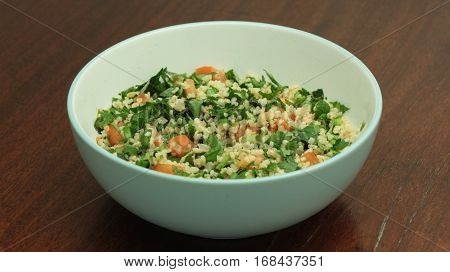 Tabbouleh Salad - Middle Eastern Vegetarian Dish With Bulgur, Tomatoes, Parsley, Spring Onion And Mi