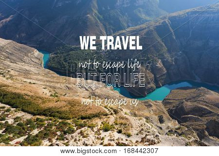 We travel not to escape life But for life not to escape us/ Inspirational Motivational Travel Journey Quote Design. Amazing Aerial view of Canyon. Landscape view.Autumn mountains landscape.