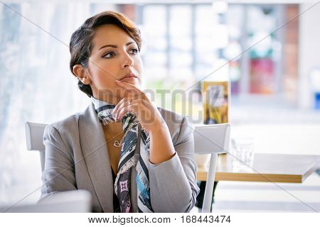 Beautiful thinking middle eastern business woman