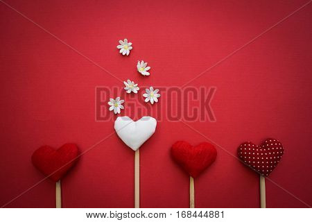Hearts made by hands as a gift for Valentine`s day. Fall in love heart