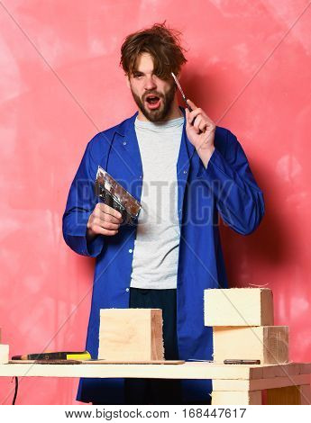Builder Man Holding Putty Knifes