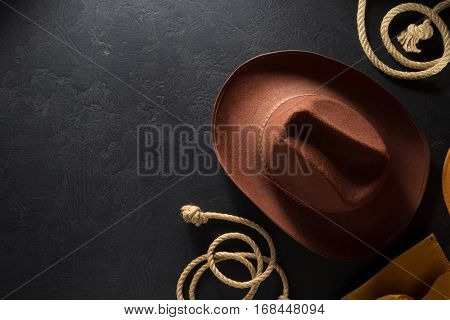 cowboy hat on black wooden background