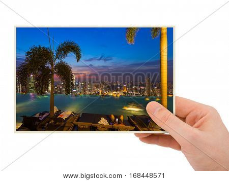 Hand and Singapore city skyline (my photo) isolated on white background