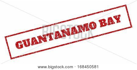 Red rubber seal stamp with Guantanamo Bay text. Vector tag inside rectangular shape. Grunge design and unclean texture for watermark labels. Inclined sign.