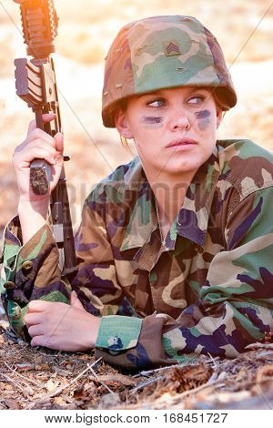 Military army woman holding gun