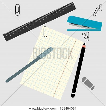Office supplies and a piece of paper on the office desk. leaf into the cell pencil stapler ruler and paper clips