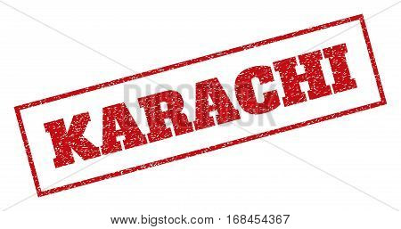 Red rubber seal stamp with Karachi text. Vector caption inside rectangular frame. Grunge design and unclean texture for watermark labels. Inclined sign.
