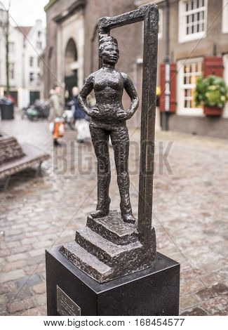 AmsterdamNetherlands-December 302016: Monument wayward prostitutes is set next to the Oude Kerk church the oldest in Amsterdam. This composition is the first and only in the world officially recognized monument prostitute