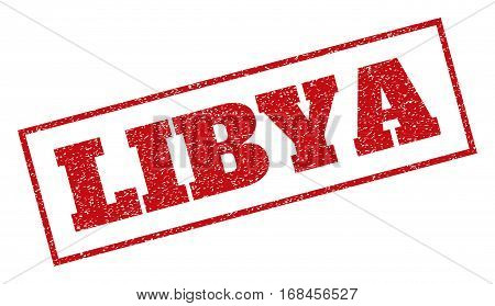 Red rubber seal stamp with Libya text. Vector caption inside rectangular frame. Grunge design and unclean texture for watermark labels. Inclined sticker.