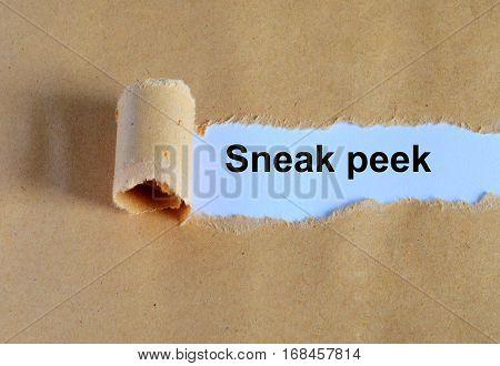 Sneak Peek Word Written Under Ripped And Torn Paper.