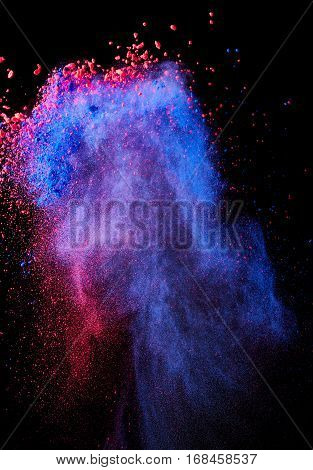 Splash of powder paint on black background