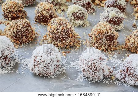Homemade chocolate truffles on a baking sheet with parchment paper.