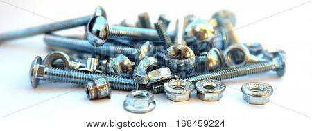 nuts and bolts isolated on white with room for your text