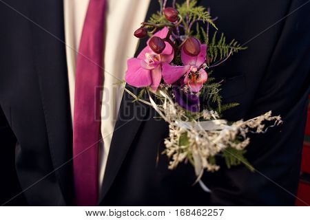Unusual Violet Boutonnieres With Orchids And Tie On Luxury Suit On Groom Close-up