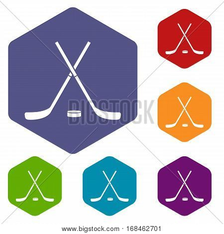 Crossed hockey sticks and puck icons set rhombus in different colors isolated on white background