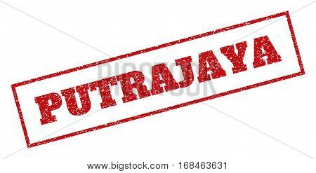 Red rubber seal stamp with Putrajaya text. Vector message inside rectangular shape. Grunge design and dirty texture for watermark labels. Inclined emblem.