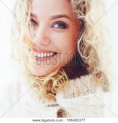 Portrait Of Beautiful Woman With Curly Hair And Adorable Smile