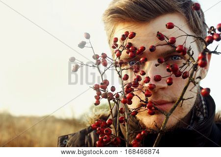 Gorgeous Stylish Beautiful Handsome Blonde Boy And Red Berries Of Hawthorn On A Background Of Sunny