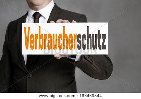 Verbraucherschutz (in German Consumer Protection) Sign Is Held By Businessman
