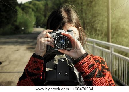 Woman Hipster Traveler Holding Analog Photo Camera In Mountains, Travel Concept, Joyful Moment
