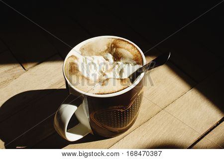 Delicious Aromatic  Brewed Whipped With Icecream Coffee In A Brown Cup With A Heart In A Sunlight In