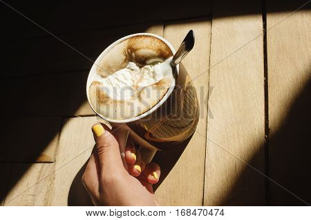Delicious Aromatic  Brewed Whipped With Icecream Coffee In A Brown Cup With A Heart In A Hand And Su