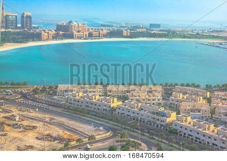Aerial view of Abu Dhabi from tourist attraction of Marina Mall Tower, an observatory above Marina Shopping Mall on Corniche Road. Urban cityscape at sunset. United Arab Emirates, Middle East.