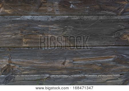 Brown rustic old wooden background. Vertical timber planks. Aged wood planks texture pattern.