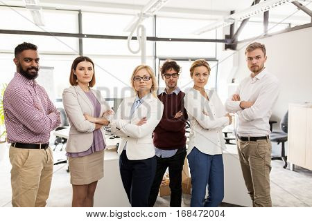 corporate, teamwork and peope concept - happy business team in office