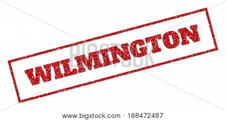 Red rubber seal stamp with Wilmington text. Vector tag inside rectangular banner. Grunge design and dirty texture for watermark labels. Inclined sign.