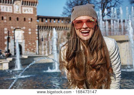 Portrait Of Happy Modern Traveller Woman In Milan, Italy