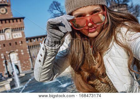 Tourist Woman Near Sforza Castle In Milan, Italy Taking Selfie