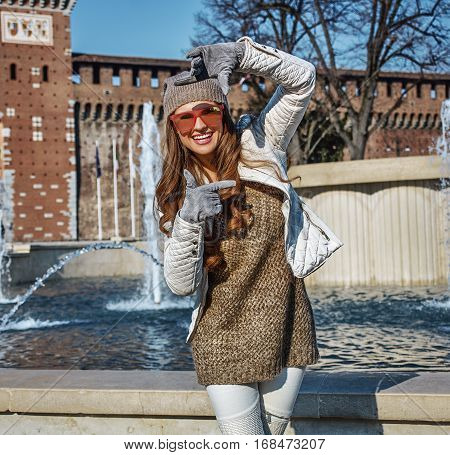 Woman Near Sforza Castle In Milan, Italy Framing With Hands